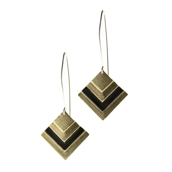 betsy & iya Black Root earrings with gold brass and black chevrons.
