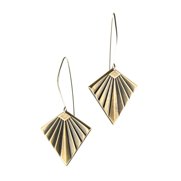 Gold deco shape earrings hang on silver wires.