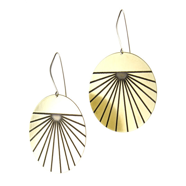 Large modern gold circle earrings with black lines and sterling silver findings.