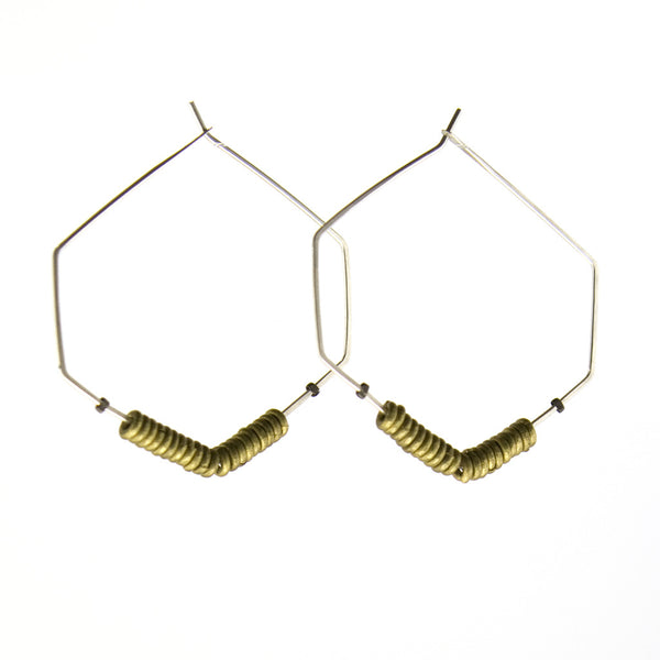 Hexagon shaped hoop earrings with brass beads and silver wires.