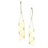 betsy & iya Sandstorm earrings with multiple triangles dangling from elegant silver ear wires.