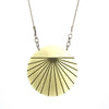 Mid-length simple gold pendant necklace.