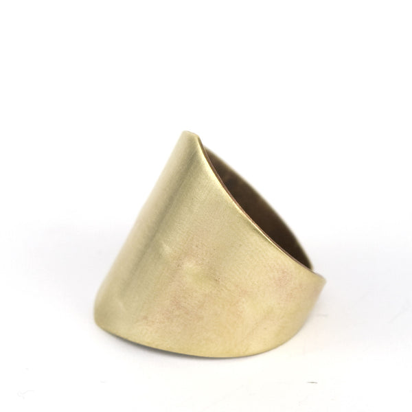 Gold wide band brass metal ring.
