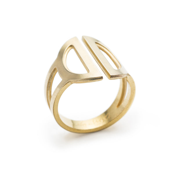Wide, adjustable, polished brass ring, featuring two triangular cutouts on the band and a pair of semicircle cutouts as the focal point. Hand-crafted in Portland, Oregon.