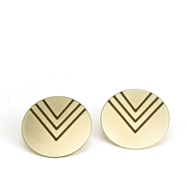 Circular post earrings with three etched v's.