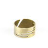 Adjustable, brushed brass ring with stacked, rectangular cutouts on the band, and the betsy & iya logo etched inside the band. Hand-crafted in Portland, Oregon.