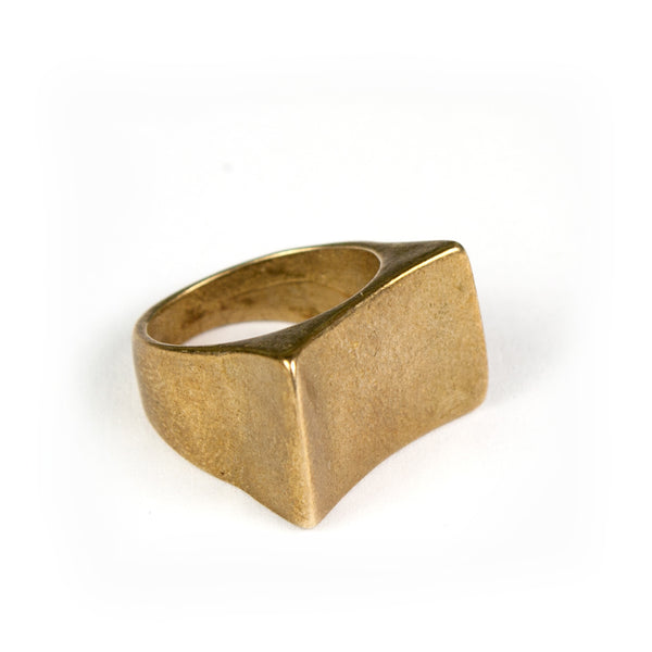 Bold bronze cocktail ring with curved rectangular top.