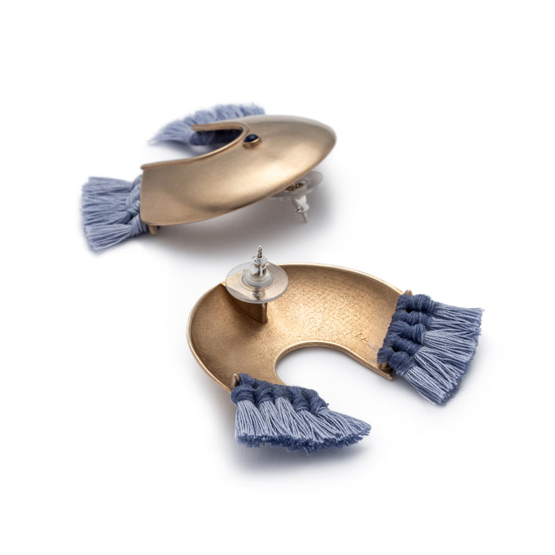 e5ecac48e ... Oversized, arc-shaped bronze earrings with light blue cotton fringe,  ethically sourced and ...