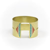 Wide, bold, brass cuff bracelet in the Mexico colorway, with a cutout slit that runs through the center of the cuff and stops just short of a pyramid of rich teal and red paint on either end. Hand-crafted in Portland, Oregon.