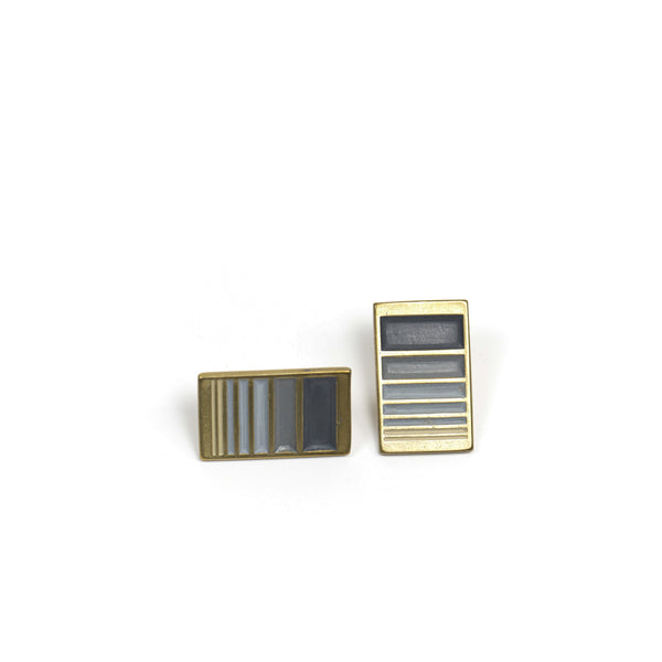 A pair of rectangular, cast-bronze stud earrings, decorated in our Portland colorway, with a gradient of gray paint. Hand-crafted in Portland, Oregon.