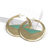 A pair of cast-bronze disc hoop earrings, decorated with a pyramid of geometric, aqua paint detail through the center of the disc, and finished with sterling silver posts and butterfly backings. Hand-crafted in Portland, Oregon.