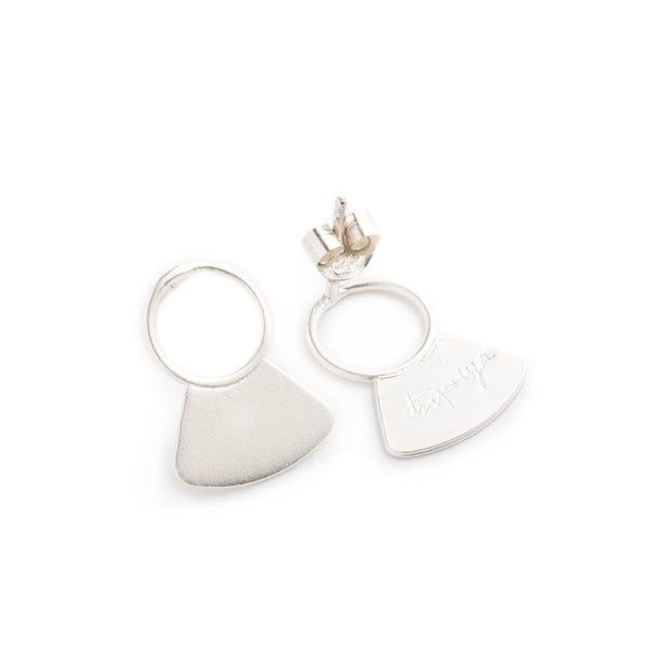 Small, sterling silver studs, featuring a delicate, open circle with a solid fan shape at the base, sterling silver earring posts and backings, and the betsy & iya logo etched on the back of the studs. Hand-crafted in Portland, Oregon.