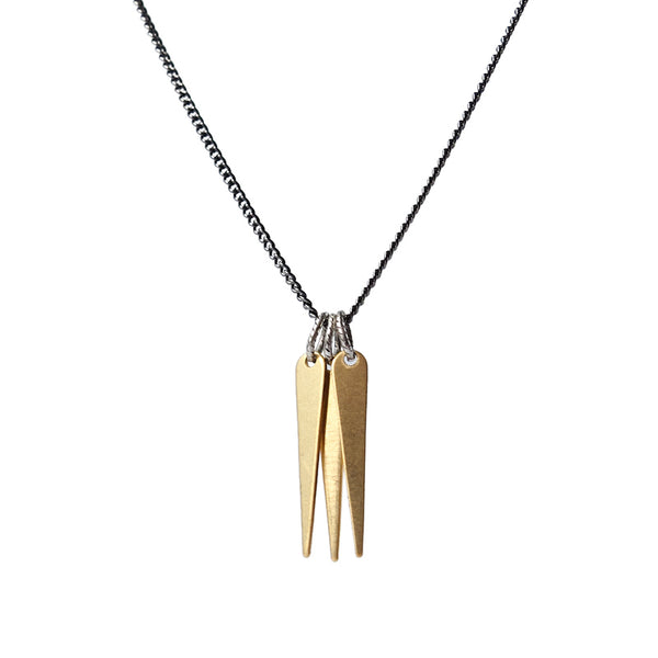 A trio of decorative brass spikes, dangling from a gunmetal and steel chain, and finished with a hand-formed, sterling silver clasp and closure. Hand-crafted in Portland, Oregon.