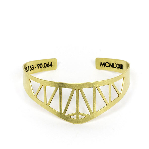 Modern, delicate, and adjustable brass cuff bracelet modeled after the Hernando de Soto Bridge in Memphis, Tennessee, with the bridge's georgraphical coordinates and date of construction engraved on the inner cuff.  Hand-crafted in Portland, Oregon.