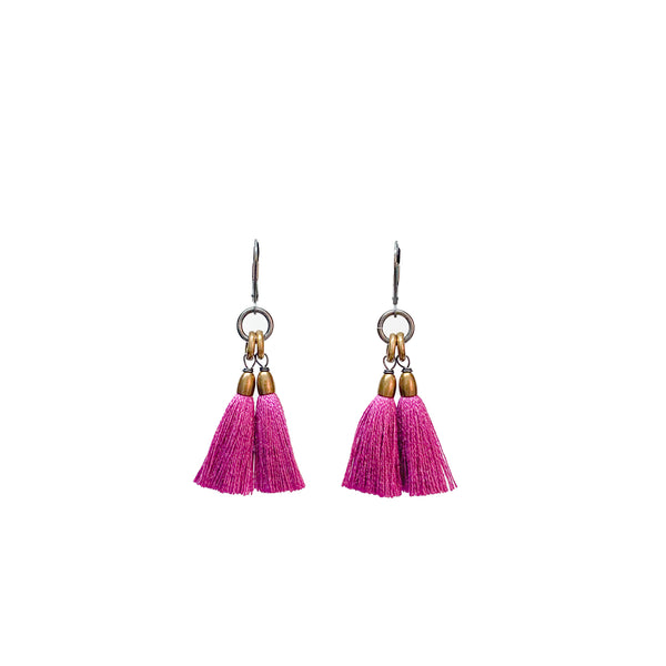 A pair of dangling earrings with fuchsia tassels and brass rings topped with a silver leverback. The Fan Earrings in Hot Violet are from Portland designer Emily Bixler of BOET.