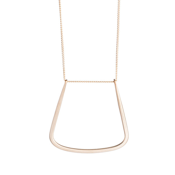 14k gold-filled chain threaded through a hand-formed, 14k gold-filled, u-shaped pendant with squared edges. Hand-crafted in Portland, Oregon.