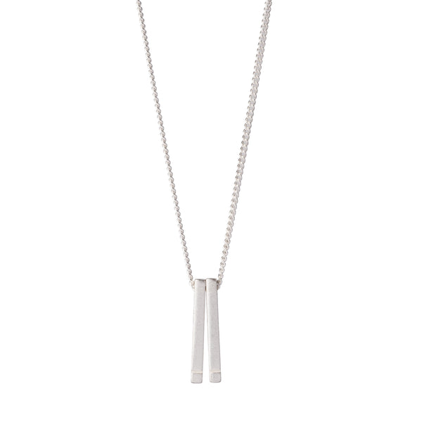 Simple, delicate, 18 inch-long necklace, with two sterling silver bars dangling from a sterling silver chain. Hand-crafted in Portland, Oregon.