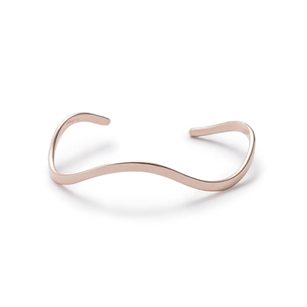 Thin, shiny, bronze cuff bracelet, with a curved, organic shape, and notch details at each end. Hand-crafted in Portland, Oregon.