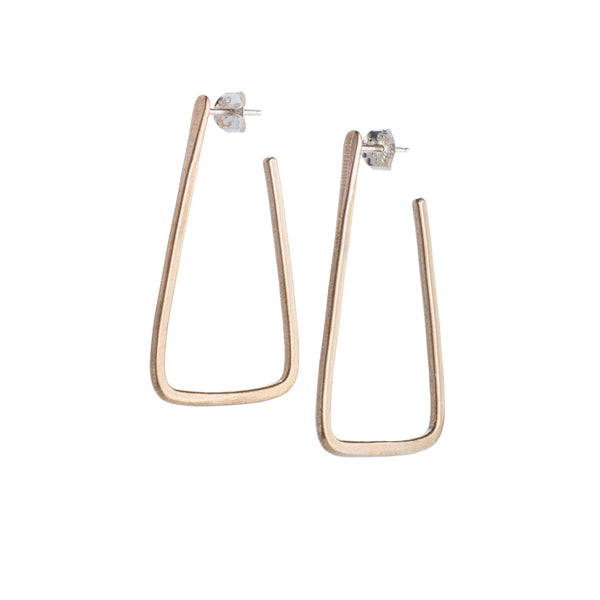 Simple, geometric, bronze hoop earrings with curved edges and a matte finish, sterling silver earrings posts, and sterling silver butterfly earring backings. Hand-crafted in Portland, Oregon.