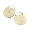 Large, round, brushed brass disc hoop earrings with a thin, rectangular cutout running down the center of the discs, and short, sterling silver earring wires that latch to the back of the discs. Hand-crafted in Portland, Oregon.