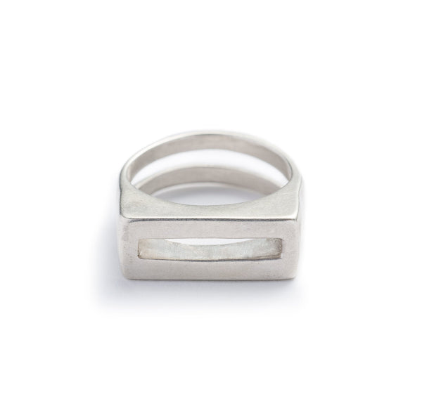 Solid, chunky, cast-silver ring with a flat top and rectangular cutouts on the band and the top of the ring. Hand-crafted in Portland, Oregon.