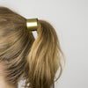 Curved metal hair elastic in brass