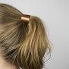 Curved metal ponytail holder in copper