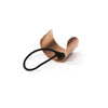 Curved metal hair tie in copper