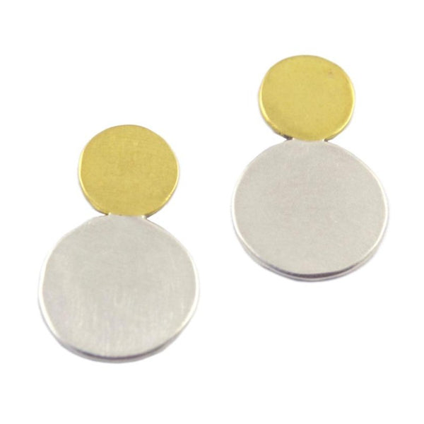 A pair of brass and silver earrings against a white background. The earrings are comprised of two circles– a smaller brass circle sits atop a medium silver circle. The Moonlet Post earrings are made by designer Natalie Joy in Portland, Oregon.