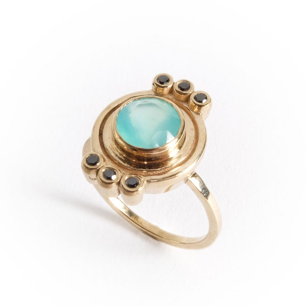 10k gold ring with round bezel set Peruvian Opal and six black diamonds by Portland designer betsy & iya