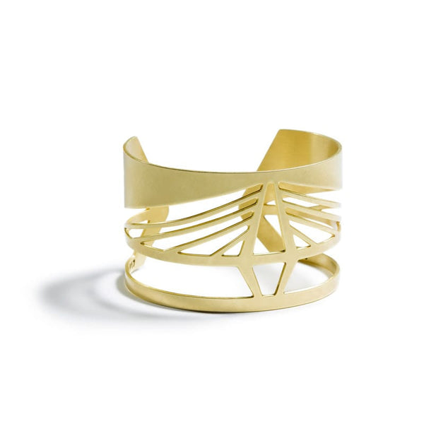 Bold, modern, and adjustable brass cuff bracelet modeled after the Ravenel Bridge in South Carolina, with the bridge's year of construction and geographic coordinates etched on the inner cuff. Hand-crafted in Portland, Oregon.