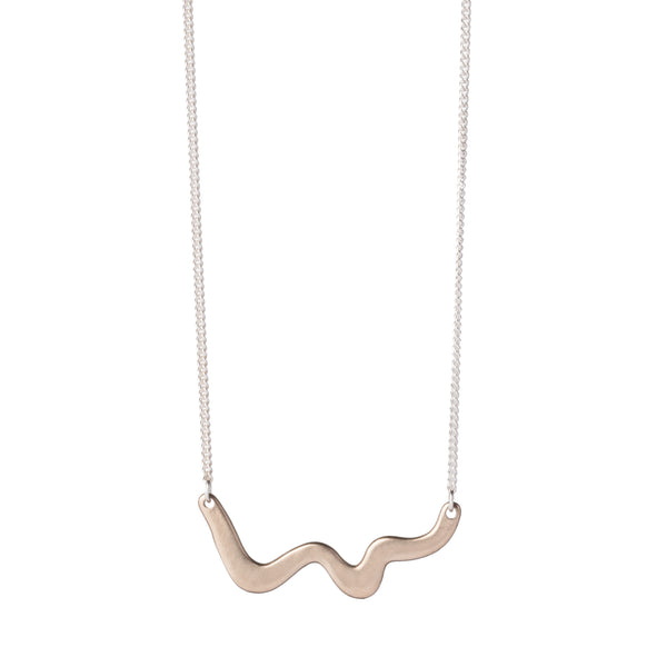 Small and delicate wave pendant of cast bronze, affixed on each end to a delicate, sterling silver chain. Hand-crafted in Portland, Oregon.