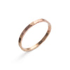 14k solid gold soldered band with a hammered texture. Hand-crafted in Portland, Oregon.