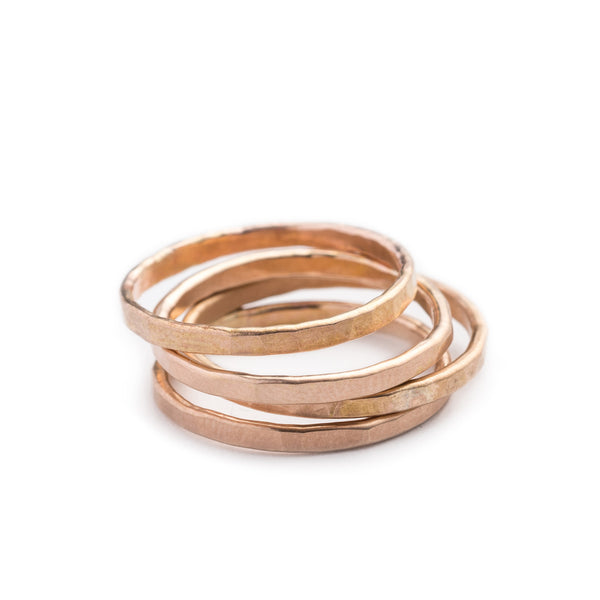 An eye-catching stack of 14k solid gold soldered bands with a hammered texture. Hand-crafted in Portland, Oregon.