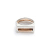 A pair of contemporary rings, featuring one thin, bronze ring with an elongated curve (Tuyo) fitted through a chunky, silver ring with a rectangular cutout (Mía). Hand-crafted in Portland, Oregon.