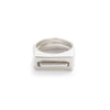 A pair of contemporary cast-silver rings, featuring one thin ring with an elongated curve (Tuyo) fitted through a chunky ring with a rectangular cutout (Mía). Hand-crafted in Portland, Oregon.