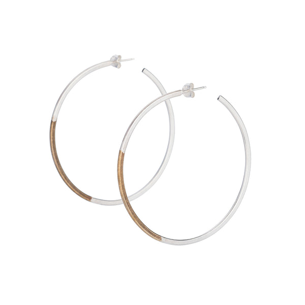 Classic, large, lightweight hoop earrings of mixed brass and sterling silver hand-forged wire, with sterling silver earring posts and sterling silver butterfly backings. Hand-crafted in Portland, Oregon.