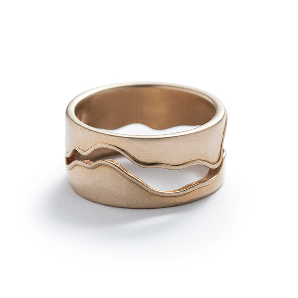 Thick, unisex, cast-bronze band, featuring a curved, wavy cutout modeled after the shape of the Willamette River in Portland, Oregon. Hand-crafted in Portland.