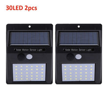 Load image into Gallery viewer, 1-4pcs LED Solar Light Motion Sensor Outdoor Garden Light Decoration Fence Stair Pathway Yard Security Solar Lamp Dropshipping