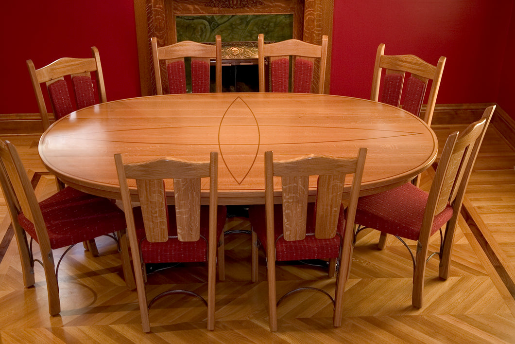 Quarter-sawn White Oak table, walnut inlay and wrought Iron base. Wrought iron seat frames.