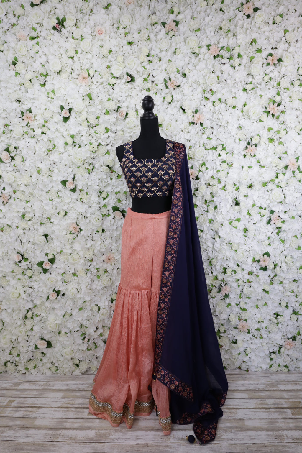 Navy crop top blouse with gold design work pair with shimmering silk pants and dark blue dupatta
