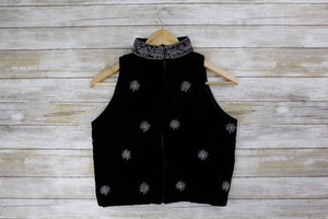 Back black sleeveless velvet blouse with heavy metal work