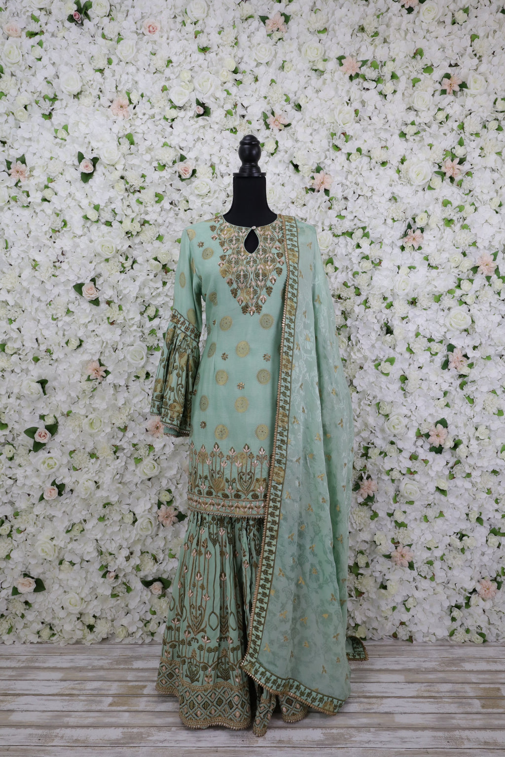 front Beautiful green gharara suit with stunning gold designs with matching dupatta.