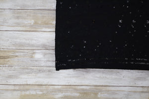 This little black dupatta features stunning sequin work to add flair and elegance.