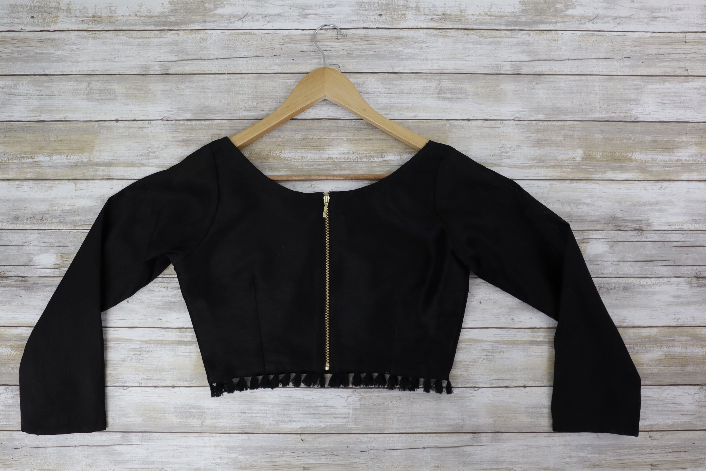 Black long sleeve raw silk blouse with black tassel details