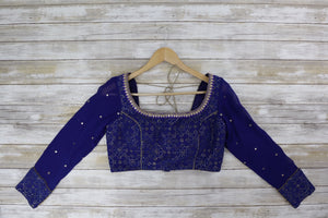 Front blue silk long sleeved blouse with shimmering gold and mirrors