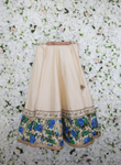 Heavey white and floral lehenga and gold trim