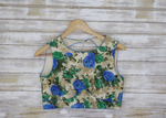 Floral sleeveless blouse with blue-green flowers and open back