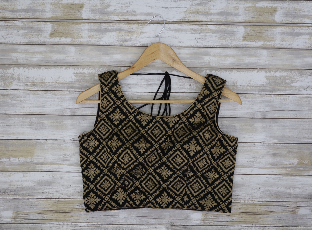 front black sleeveless blouse with gold embroidery