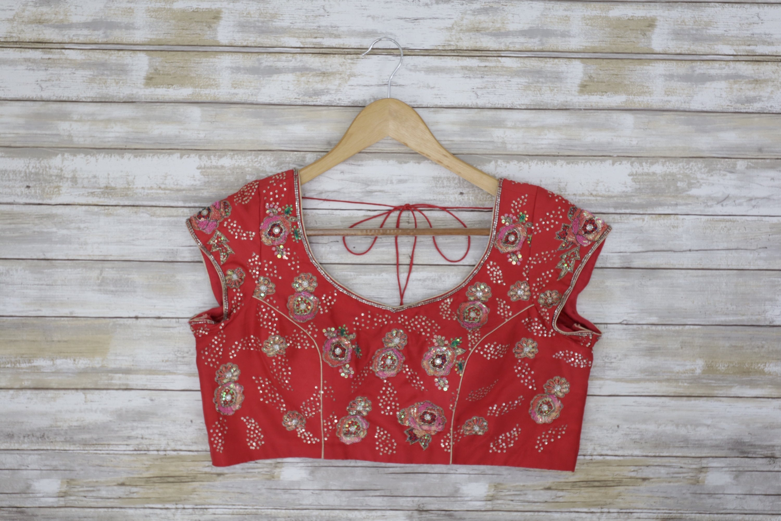 Salmon pink short sleeved blouse with beaded floral design and open back
